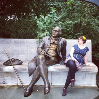 {Photo: a statue of George Mason with a book in his hand, looking off into the distance contemplatively, and me next to him, imitating his pose}