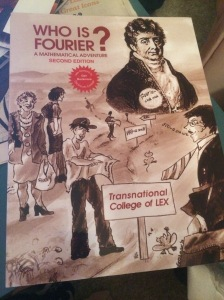 "{Photo: Textbook. ""Who Is Fourier? A Mathematical Adventure"" by the Transnational College of LEX. Has some illustrations of some old white dudes, you know, as college textbooks do. But it's really good!!}"